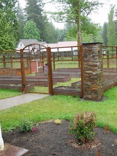 Garden gates and fencing with rock columns backyard for Garden fence features