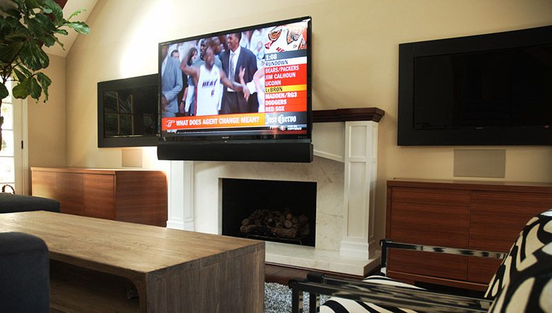High end interior design television mount over fireplace for Motorized tv mount over fireplace