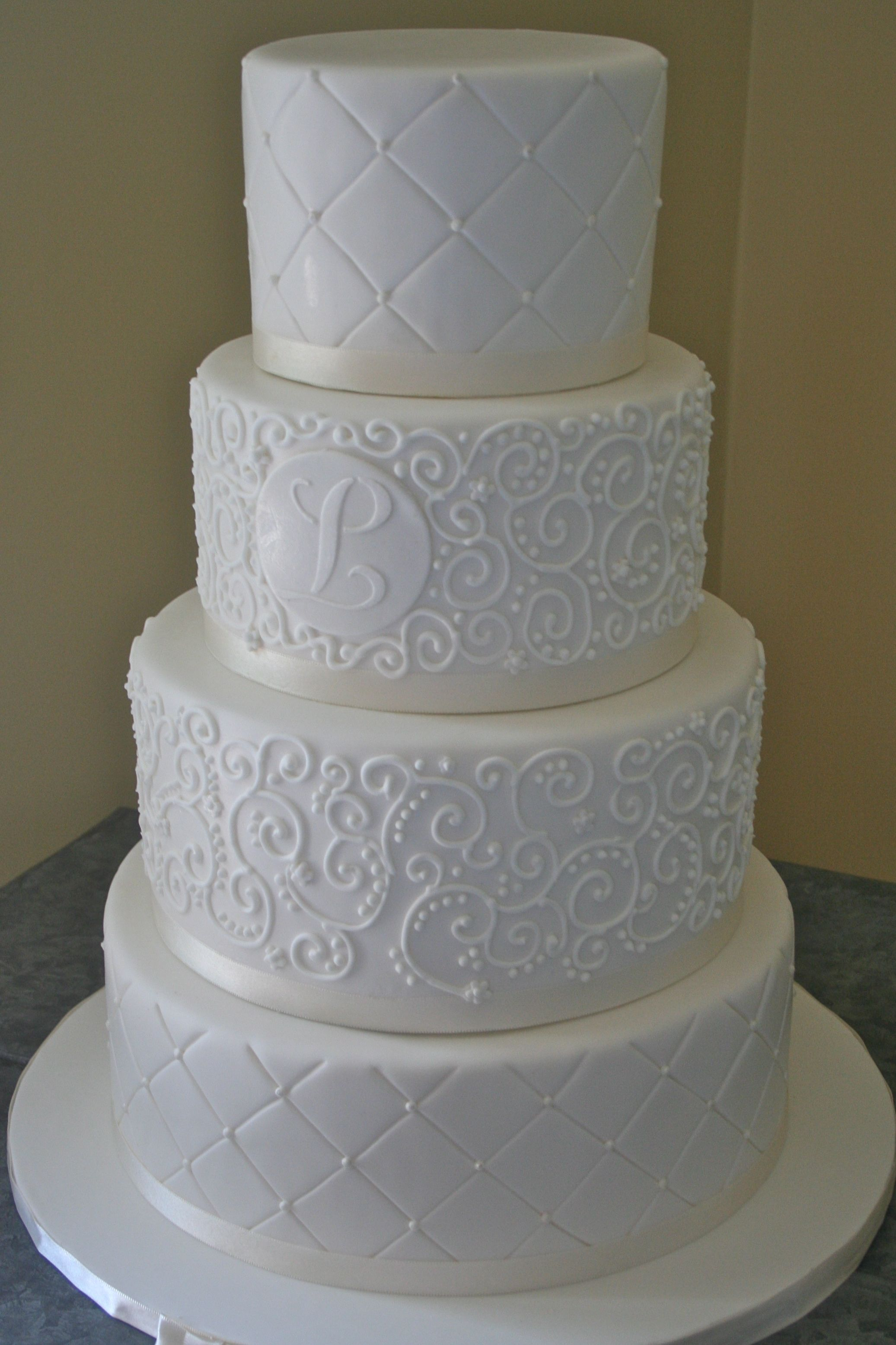 White-on-white wedding cake.  Created by Renay Zamora of Sweetface Cakes in Nashville, TN.