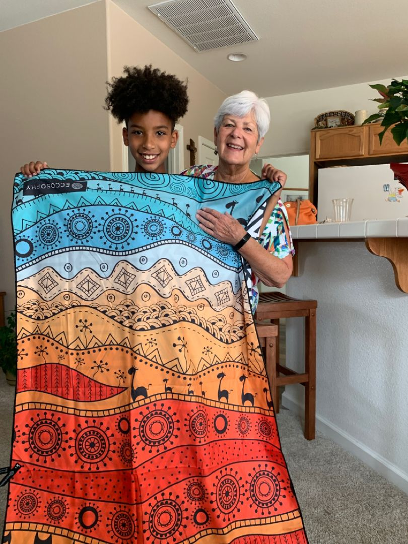"""""""My son turned 11 and his grandmother got him this because it reminded her of Africa where he wants to visit""""   Thank you to @mikie.b.franklin who absolutely melted our hearts 😭❤️  #ECCOSOPHY #ECCOSOPHYTowel #beachtowel #quickdry #sandfree #travel #travelgear #travellightwithus #Marrakesh #family #microfiber #beachday #pooltime"""