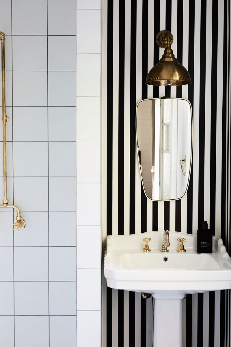 fancy bathroom with black & white striped wallpaper and