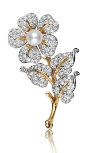 TIFFANY & CO. A Diamond and Cultured Pearl Flower Brooch  Designed as a pavé-set diamond flower, centering on a cultured pearl, extending a polished gold stem and pavé-set diamond leaves, mounted in platinum and 18K yellow gold, length 2 1/4 inches. Signed 'Tiffany & Co.'