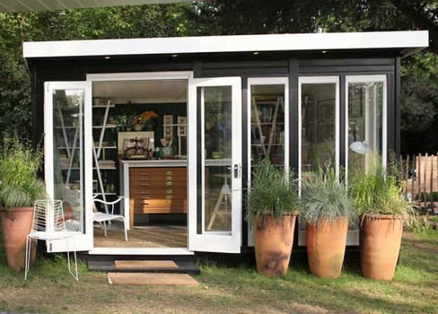 This garden shed doubles as a bookbinder\u0027s workshop with full-length