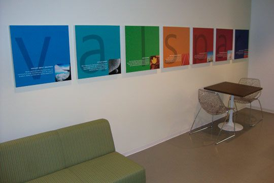healthcare backlit signage | Corporate showroom utilizes frosted glass vinyl, painted wood icons ...