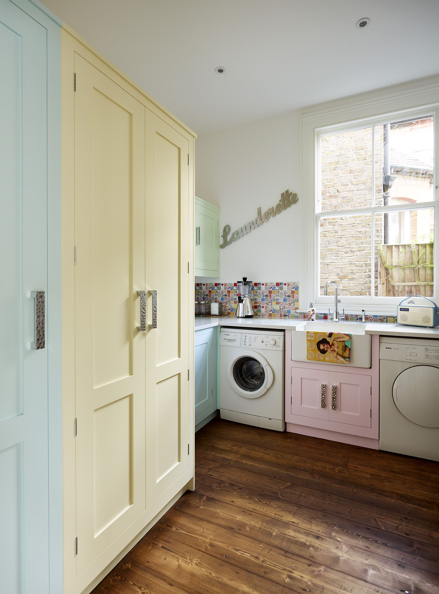 A Harvey Jones Shaker utility room, handpainted in multiple colours ...