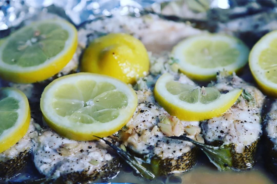 Fresh White Croaker caught from  Oxnard California Channel Islands For this recipe we simply laid over finely chopped garlic garnished with sesame oil salt pepper and lem...