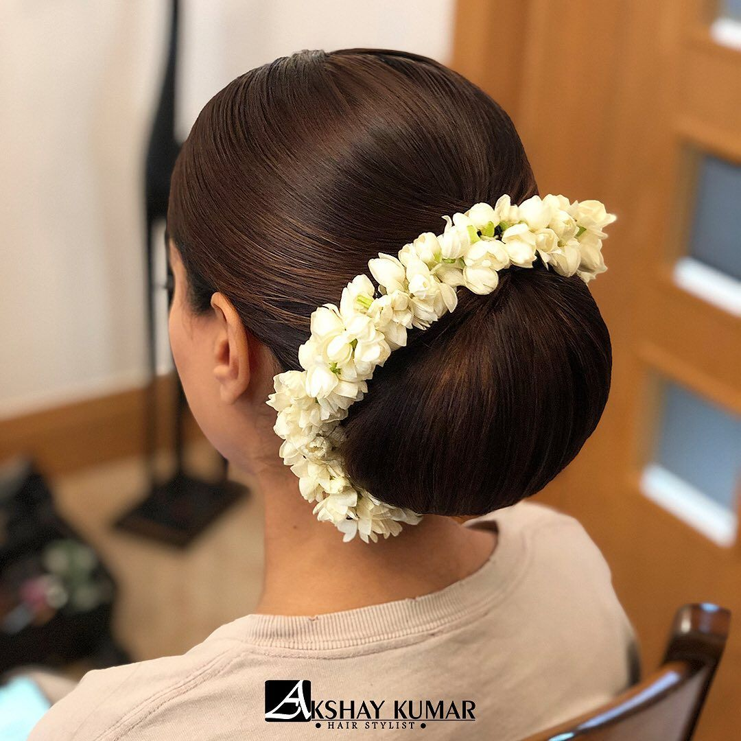 Another One Sleek Buns And Fresh Flowers Will Always Be A Favourite Hair By Akshaykumarhairstylist Low Bun Hairstyles Big Bun Hair Bun Hairstyles