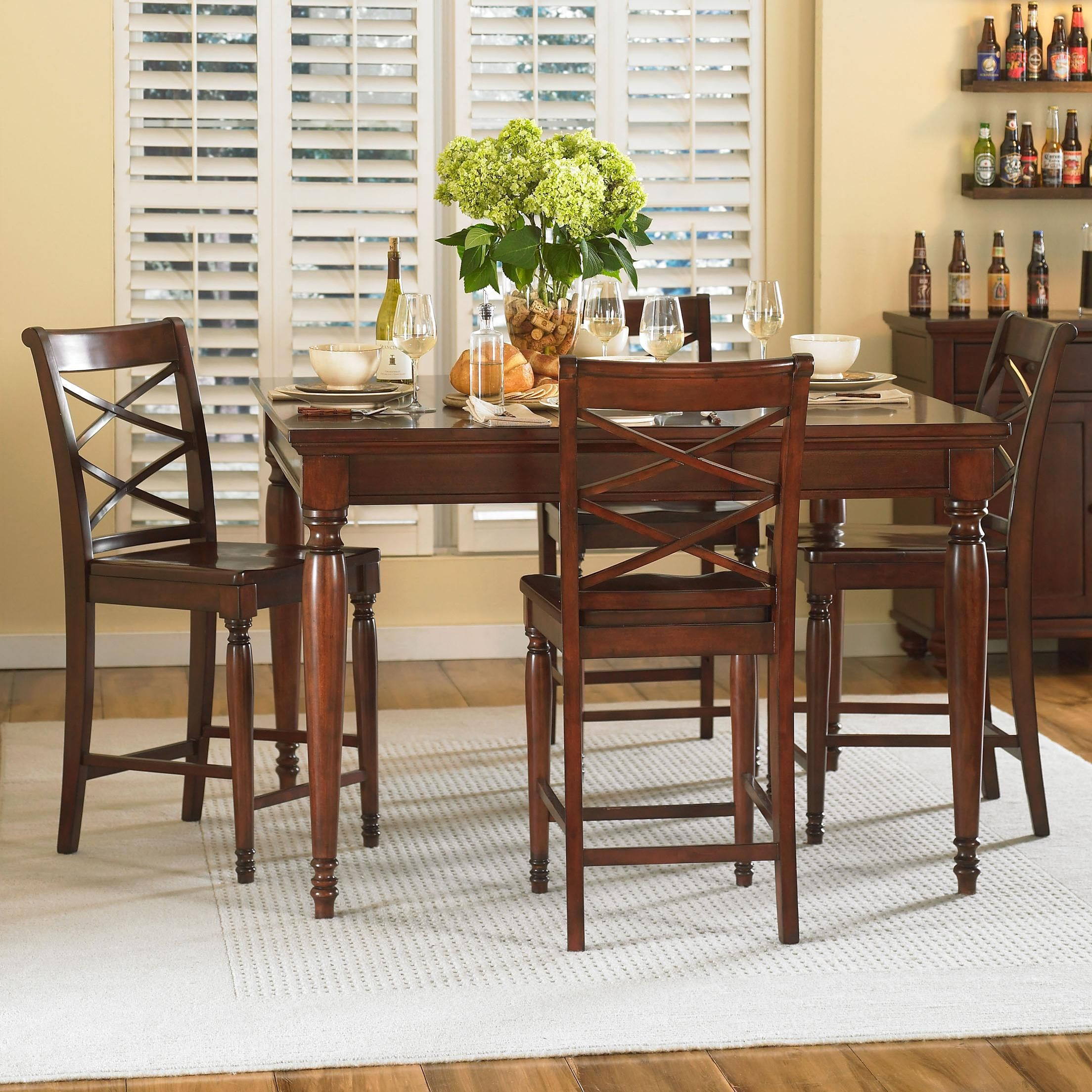 Counter height gathering table with stored leaf makes an inch