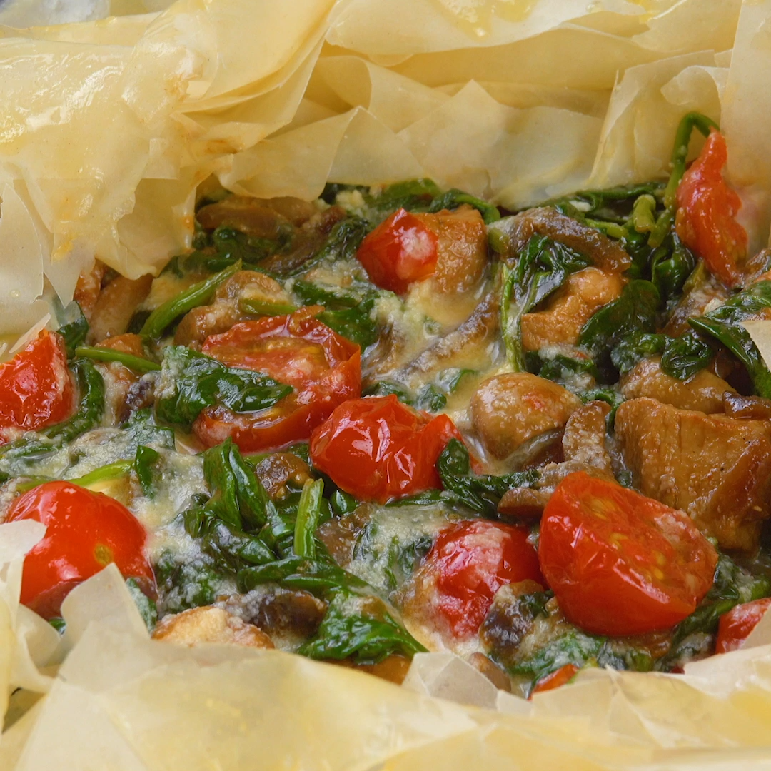 Photo of Pan dish with pork and vegetables in a filo pastry nest