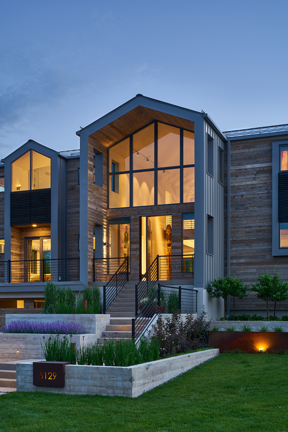Beachfront Luxury Modern Home Exterior At Night: A Unique Lakeside Setting Informs The Design Of This Ground-up, Single-family Home. Respect