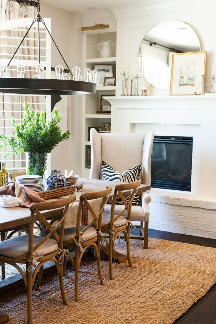 Farmhouse Dining Room With White Painted Fireplace And