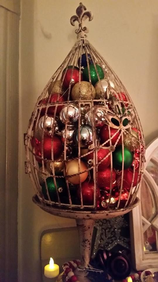 Birdcage Filled With Christmas Ornaments On The Mantel Christmas