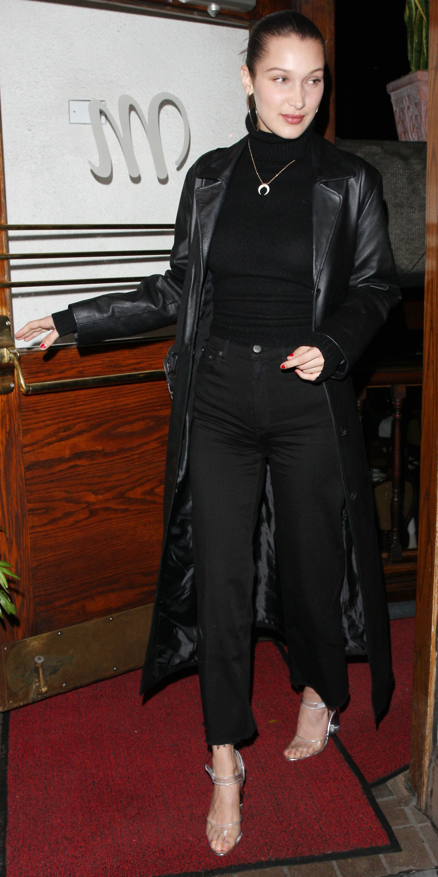 Bella Hadid Showed Us That All Black Doesn T Have To Be Boring Mixing In Luxe Fabrics Into He Leather Coat Outfit Leather Trench Coat Woman Trench Coats Women [ jpg ]