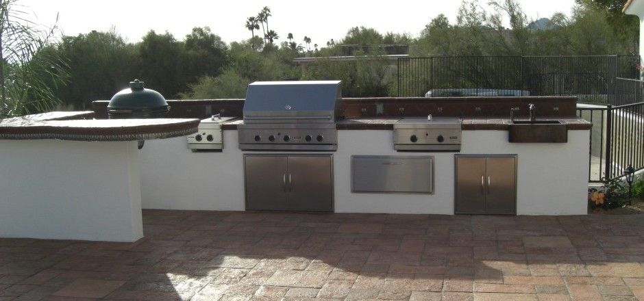 White Stucco Outdoor Kitchen With Dark Tiled Countertop By Deset Crest And San Antonio Concrete