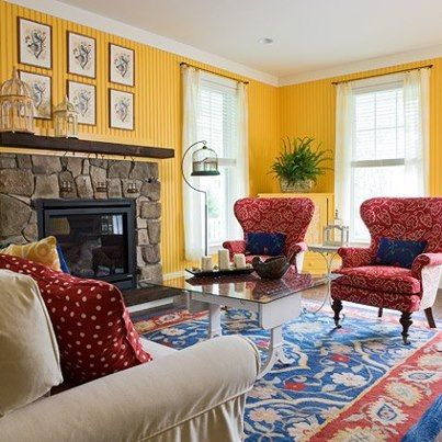 This triadic color scheme mixes the warm colors of red and for Dark yellow living room