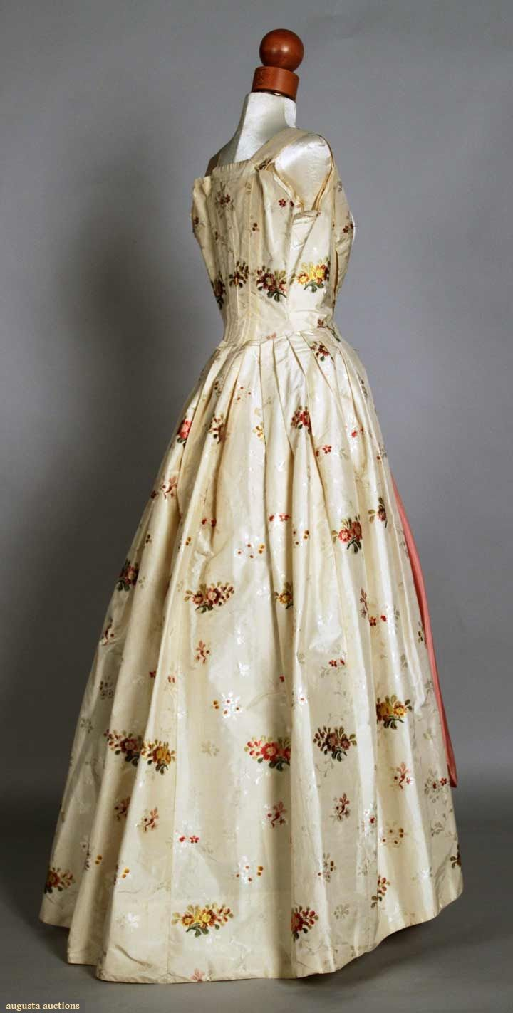 PARTIAL SPITALFIELD SILK BROCADE DRESS, 1765-1780 Robe a l'anglaise of cream ground brocaded w/ floral sprays in cherry red, gold & green, open front skirt, sleeves removed, bodice re-worked, fabric very good-excellent.