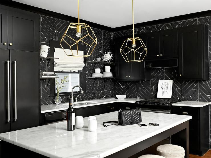 Black and white kitchen features black shaker cabinets ...