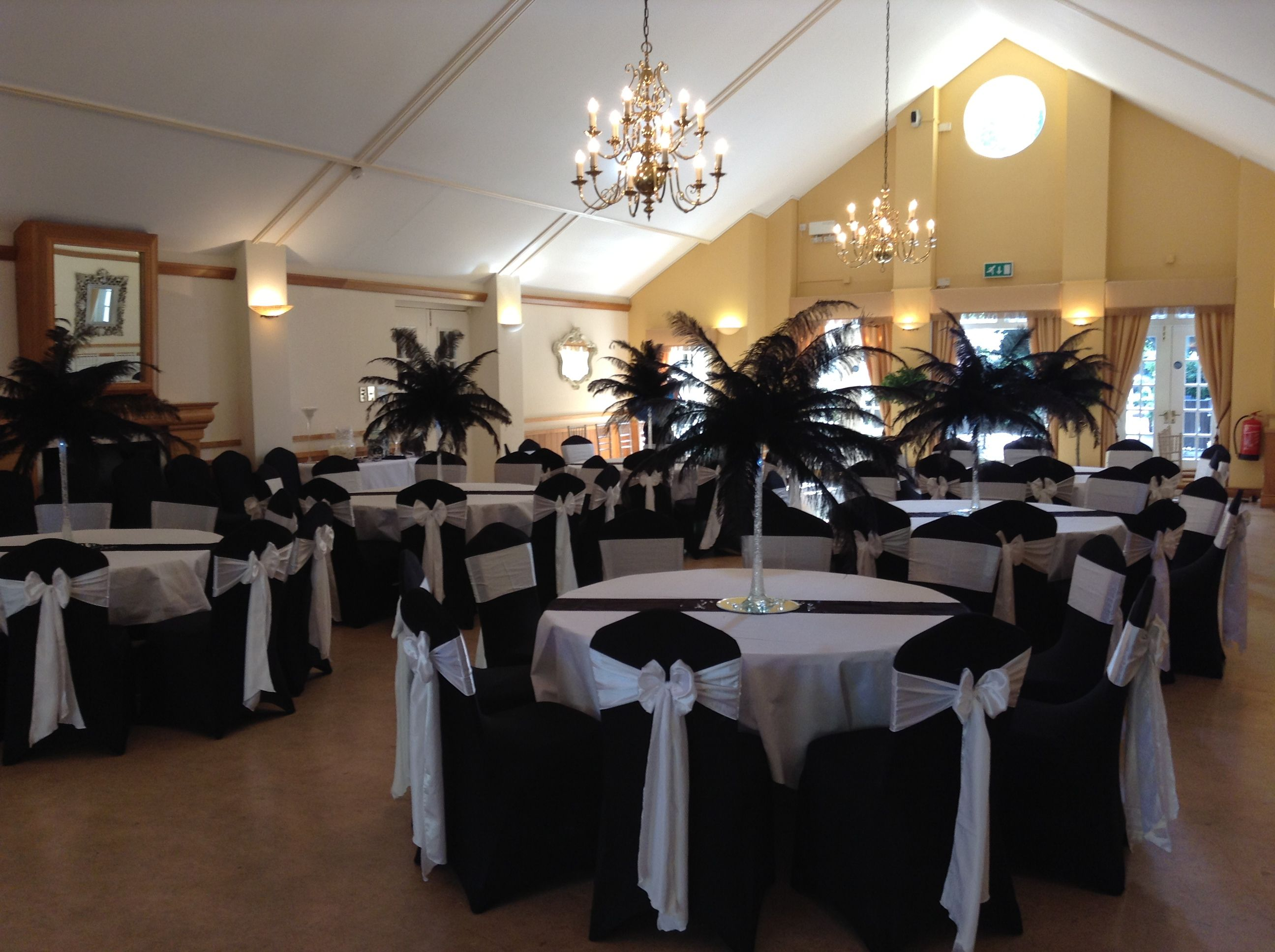 Black chair cover with white satin sash seat covers and bows