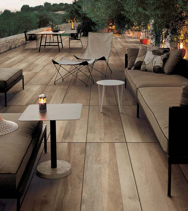 a stunning patio built with 48 x 16 wood look porcelain pavers wood look porcelain tiles in. Black Bedroom Furniture Sets. Home Design Ideas