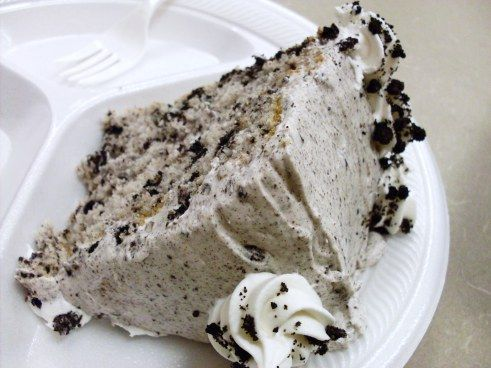 Oreo Cookie (or Cookies 'n Cream) Cake with cream cheese crushed Oreos Frosting ~ Says: I love this cake... The frosting. Oh, the frosting.  It is like….heaven. I could just eat the bowl of frosting!