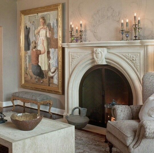 Soft neutral wallpaper and a beautiful painting in a gilded mirror make a statement in this #French styled room.