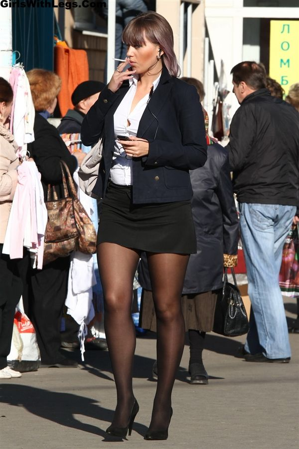 Office Girl Wearing a Very Short Skirt and Black Pantyhose