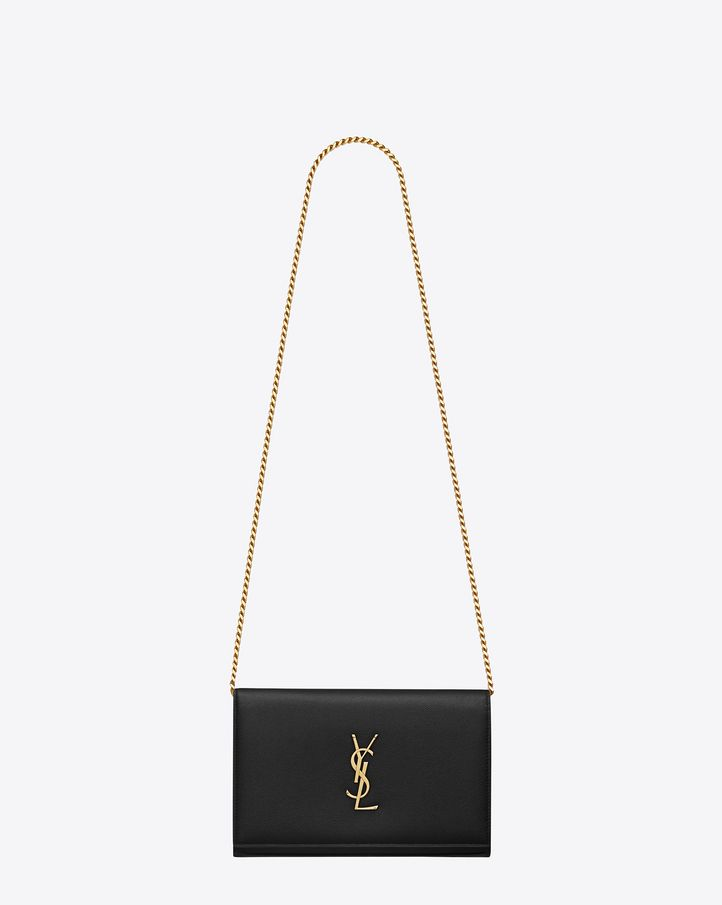 Classic SAINT LAURENT flap front wallet with removable metal chain and metal interlocking YSL signature. $1490