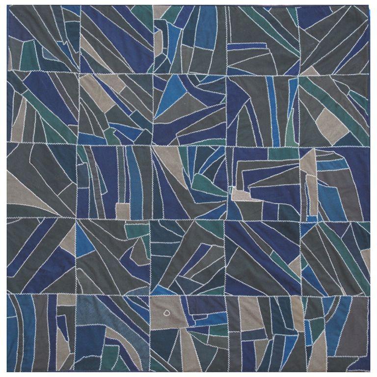 North Carolina Strip Quilt, circa 1930-1940. Twenty-five block design made of strips of assorted wools. Turkey track stitches.
