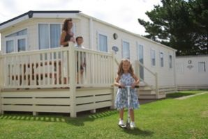The Deckhouse is our top of the range Premium 3 bedroom caravan sleeping up to 6 people with a Digital LCD TV and DVD player in the lounge and fully equipped kitchen. The Deckhouse also has a decking area with table and chairs to enjoy those long summer evenings in South Devon