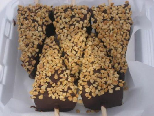 food a chocolate dipped cheesecake on a stick