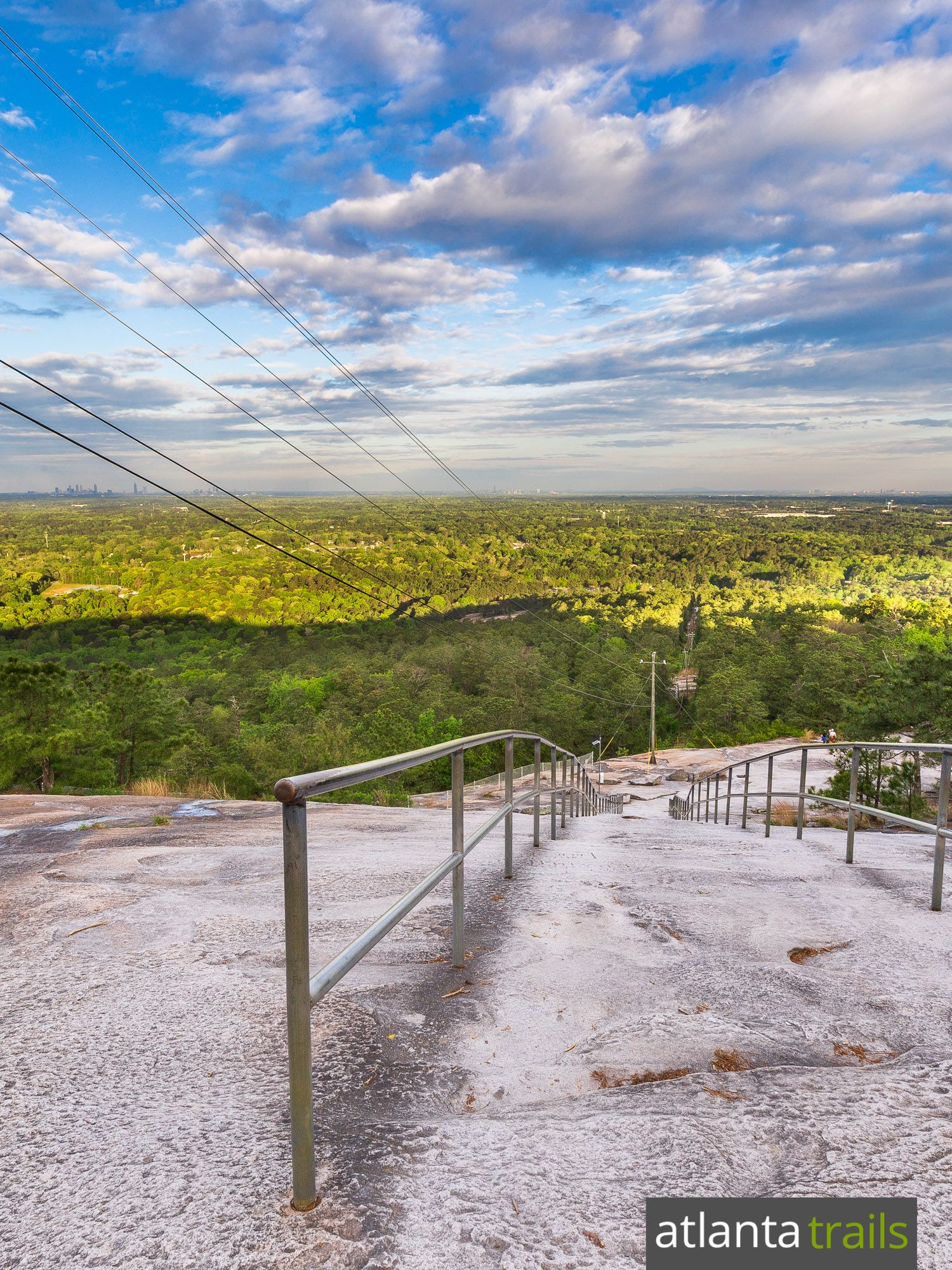 Hike the Stone Mountain Trail near Atlanta, climbing steep sections of the iconic, domed mountain to beautiful Atlanta skyline views