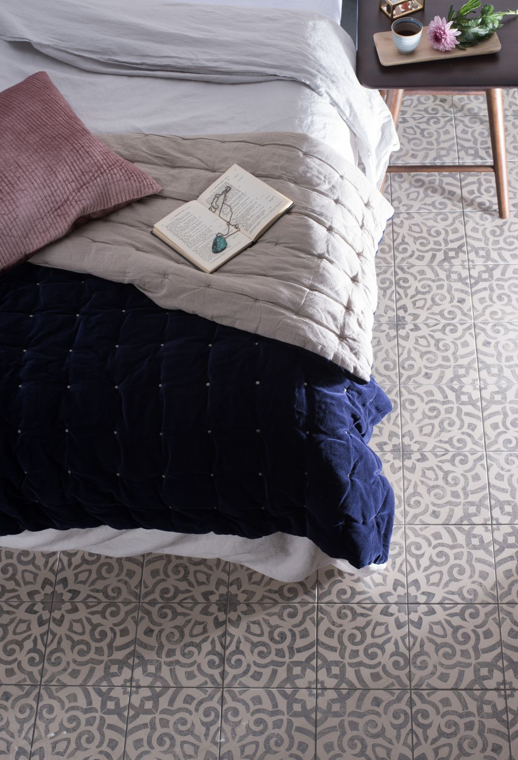 Tile ideas: while tiles are not the go-to choice for bedroom flooring, they are actually a great choice. Pretty vintage tiles add pattern and texture to the room while also being a maintenance choice. Make the space feel cosier by adding a rug or two. Find the perfect style of patterned tiles for your home with our guide. #vintageinteriordesign #bedroomdesign