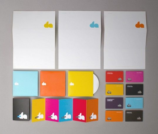 Minimalistic stationary design. I like the simple use of color and die cut.