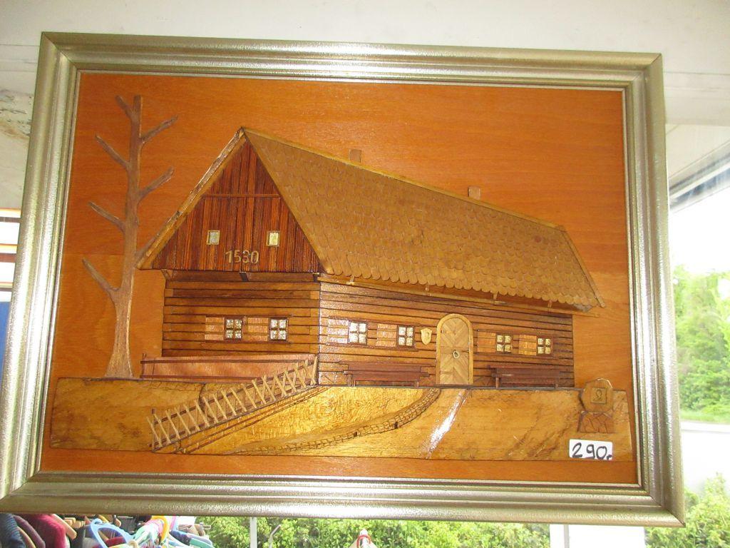 Bild vom Thema eines Holzhaus geschnitzelt bei HIOB Muttenz  #Schnäppchen #Trouvaille
