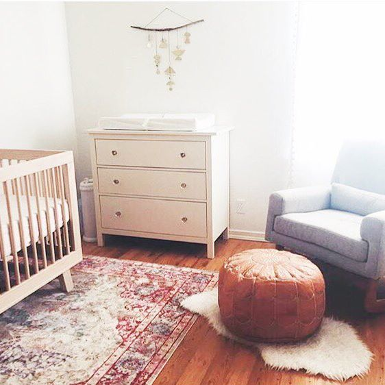 Modern Nursery With Moroccan Pouf And Persian Rug.