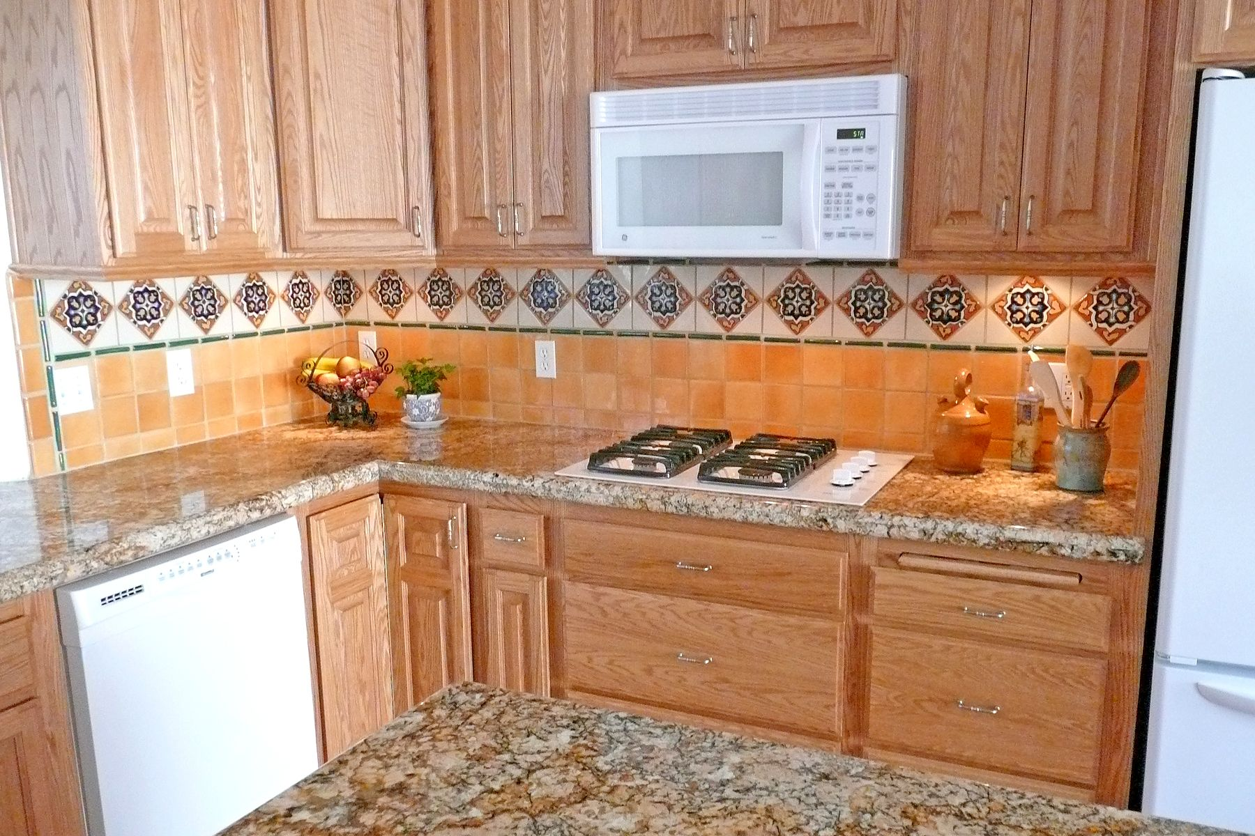 Kitchen With Mexican Tiles Backsplash.