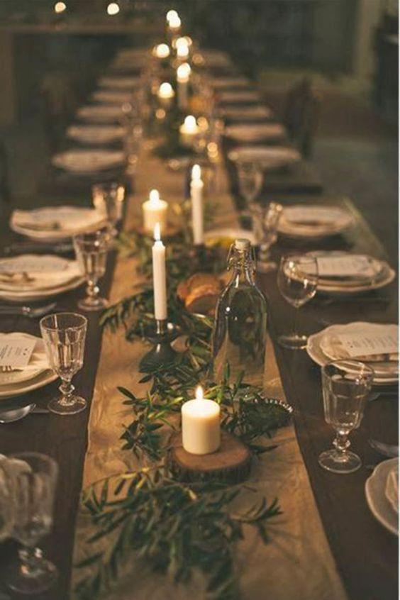 Centrotavola fatto con candele e rami