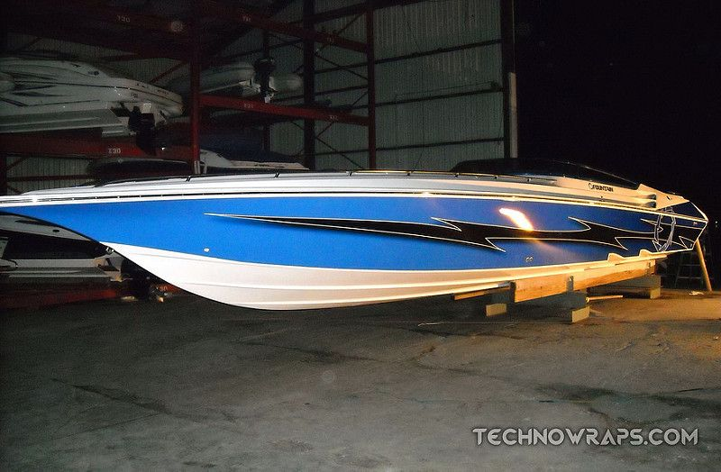 Boat wrap graphics on a 42' Fountain Lightning | Boat Wrap