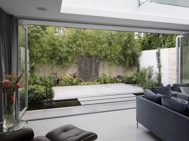 Bringing the garden into the room. Great doors.