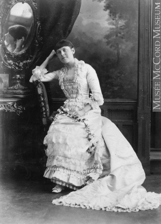Mrs. Meeker (Caroline Isabel Gilmour), in her wedding dress, Montreal, QC, 1882 Notman & Sandham April 6, 1882 Silver salts on paper mounted on paper - Albumen process II-64699.1 © McCord Museum