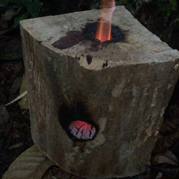 I lit a candle nub in this log rocket stove and left it for about ...