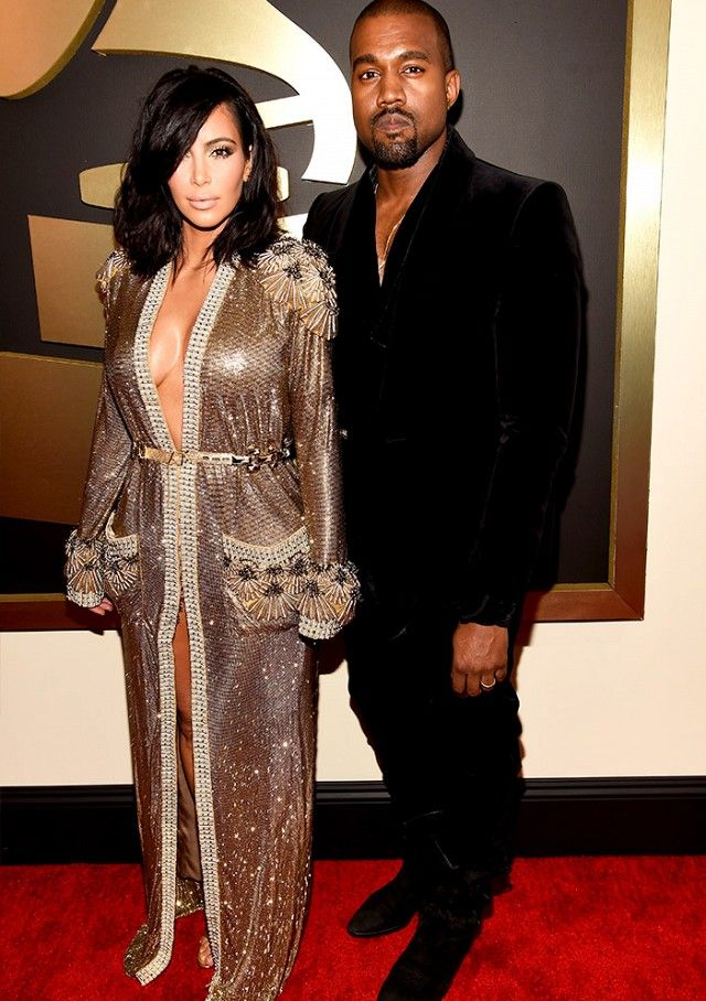 Kim Kardashian with Kanye West at the 2015 Grammys wearing a low-cut metallic embroidered Jean Paul Gautlier dress
