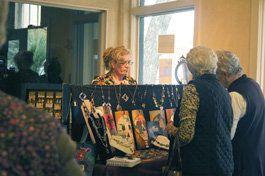Photo by Joyce Pollard  Debra Worrell Hernandez greets Art Mart visitors.