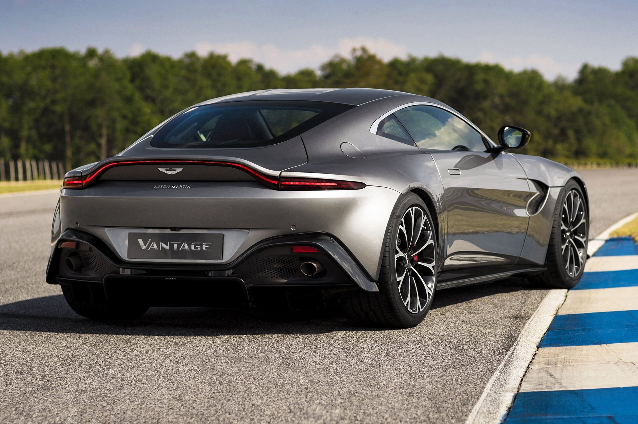 2019 Aston Martin Vantage rear side view on track
