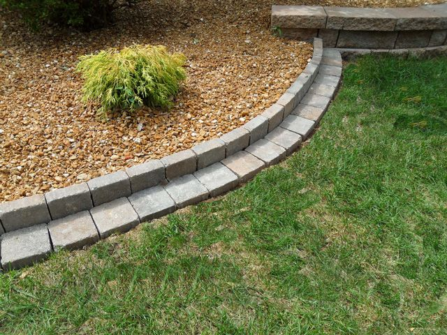 Love this roman stone edging design this would help keep for Flower bed edging stone