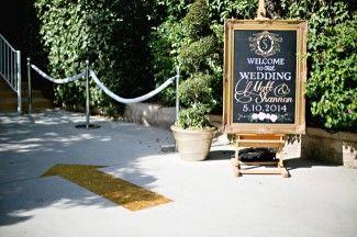 A very elegant wedding entrance sign and arrow