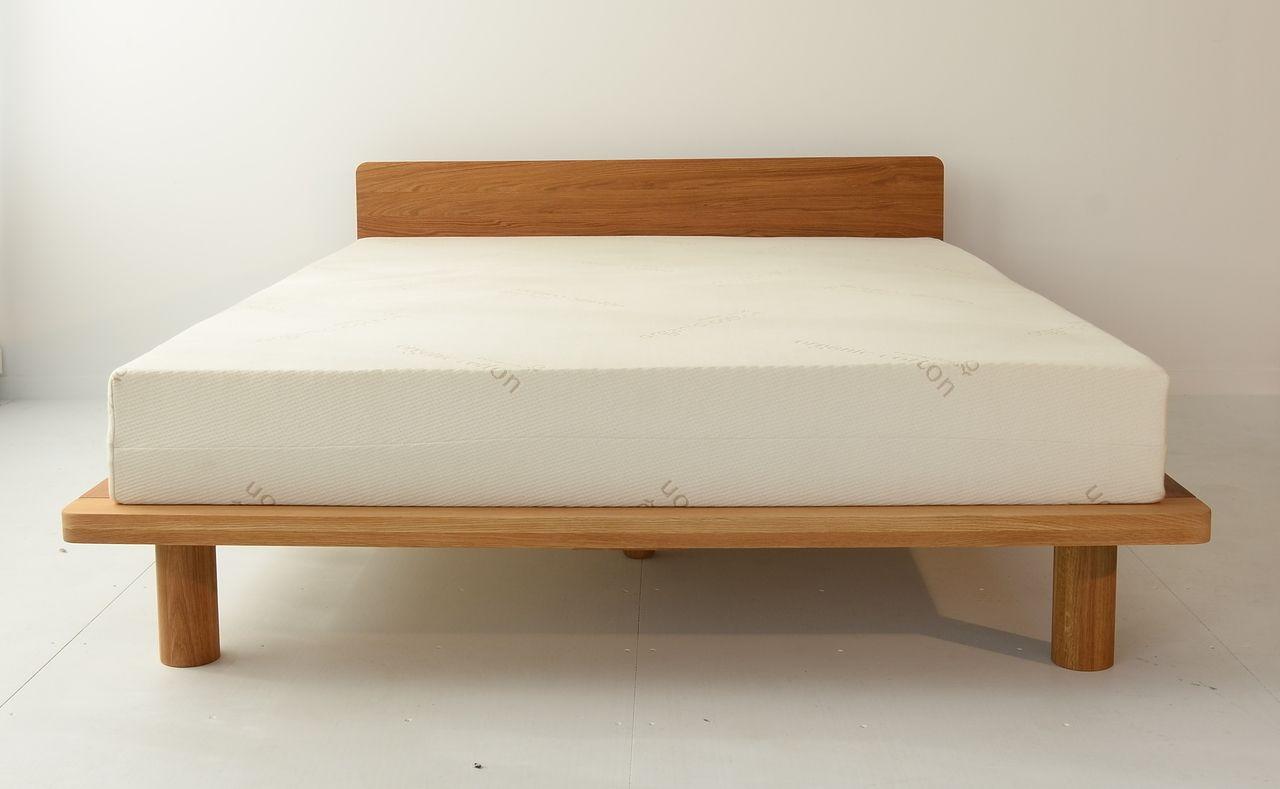 zen platform bed frame with head board in solid american oak