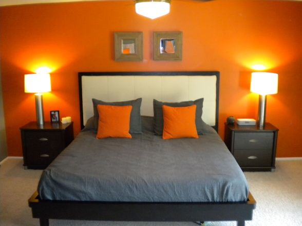 I love this the one orange accent wall brings up the for White and orange bedroom designs