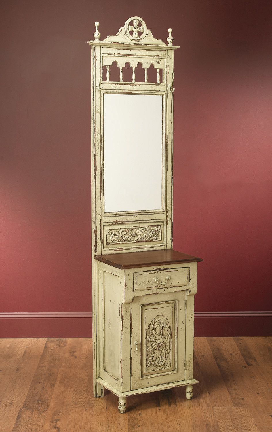 Features:  -Hand carved.  -Antiqued finish.  -Tasteful distressing.  Distressed: -Yes.  Hardware Finish: -Painted to match.  Material: -Wood.  Hardware Material: -Brass. Dimensions:  Overall Height -