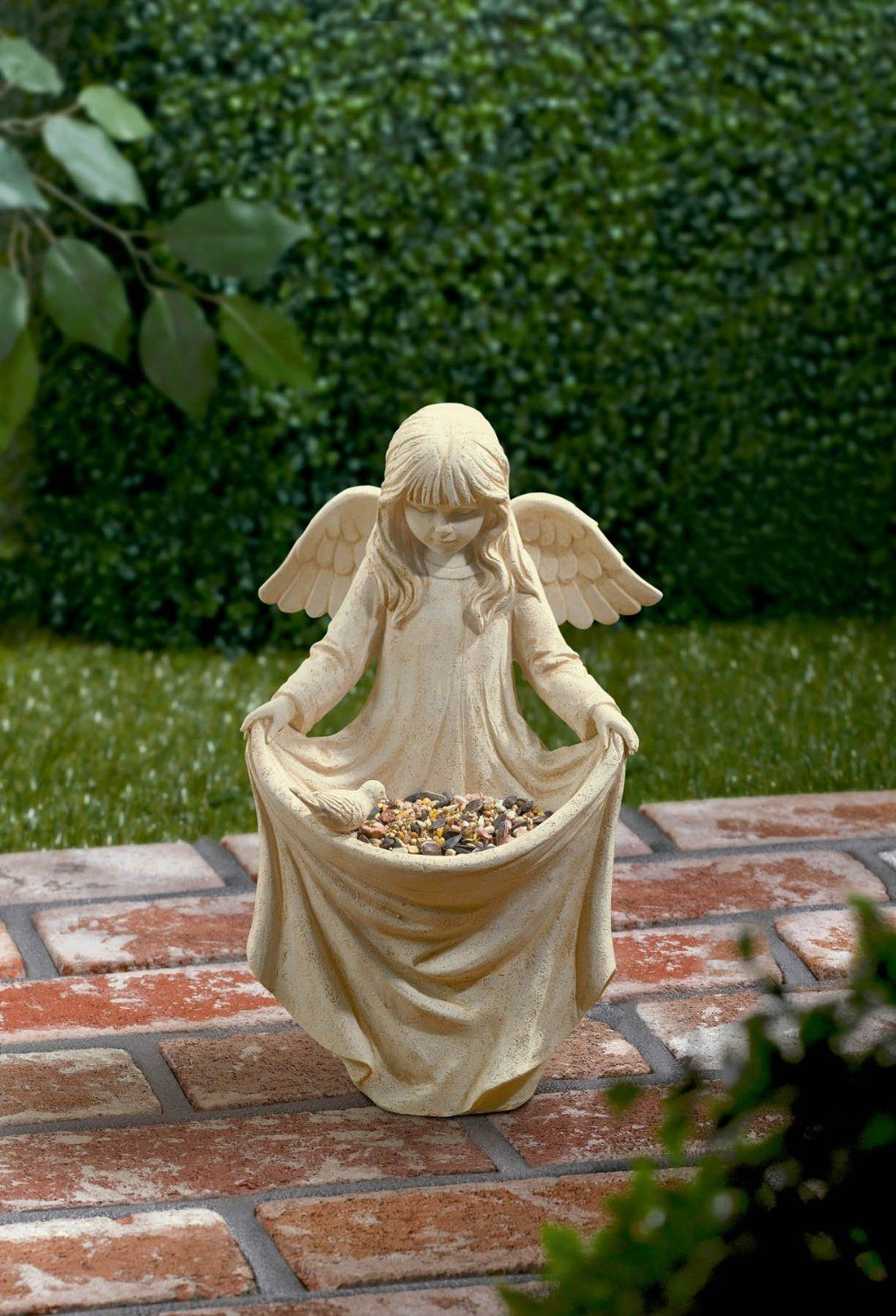 Such An Adorable Little Angel Statue Holding Her Skirt To